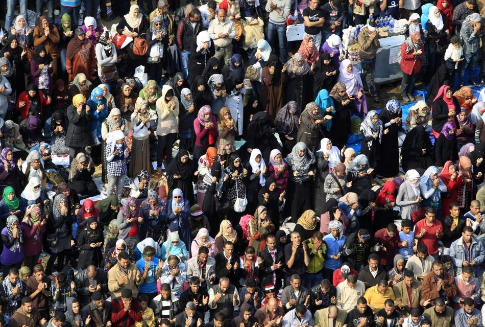 Egyptian protesters pray during a march in Tahrir Square in Cairo