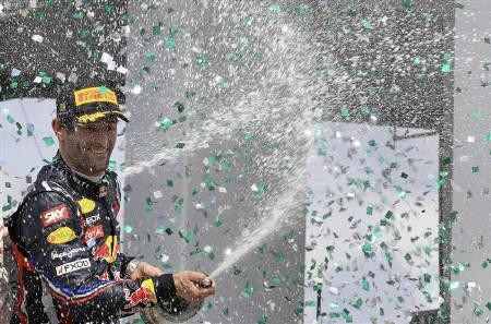 Red Bull Formula One driver Mark Webber of Australia celebrates after winning the Brazilian F1 Grand Prix at the Interlagos circuit in Sao Paulo