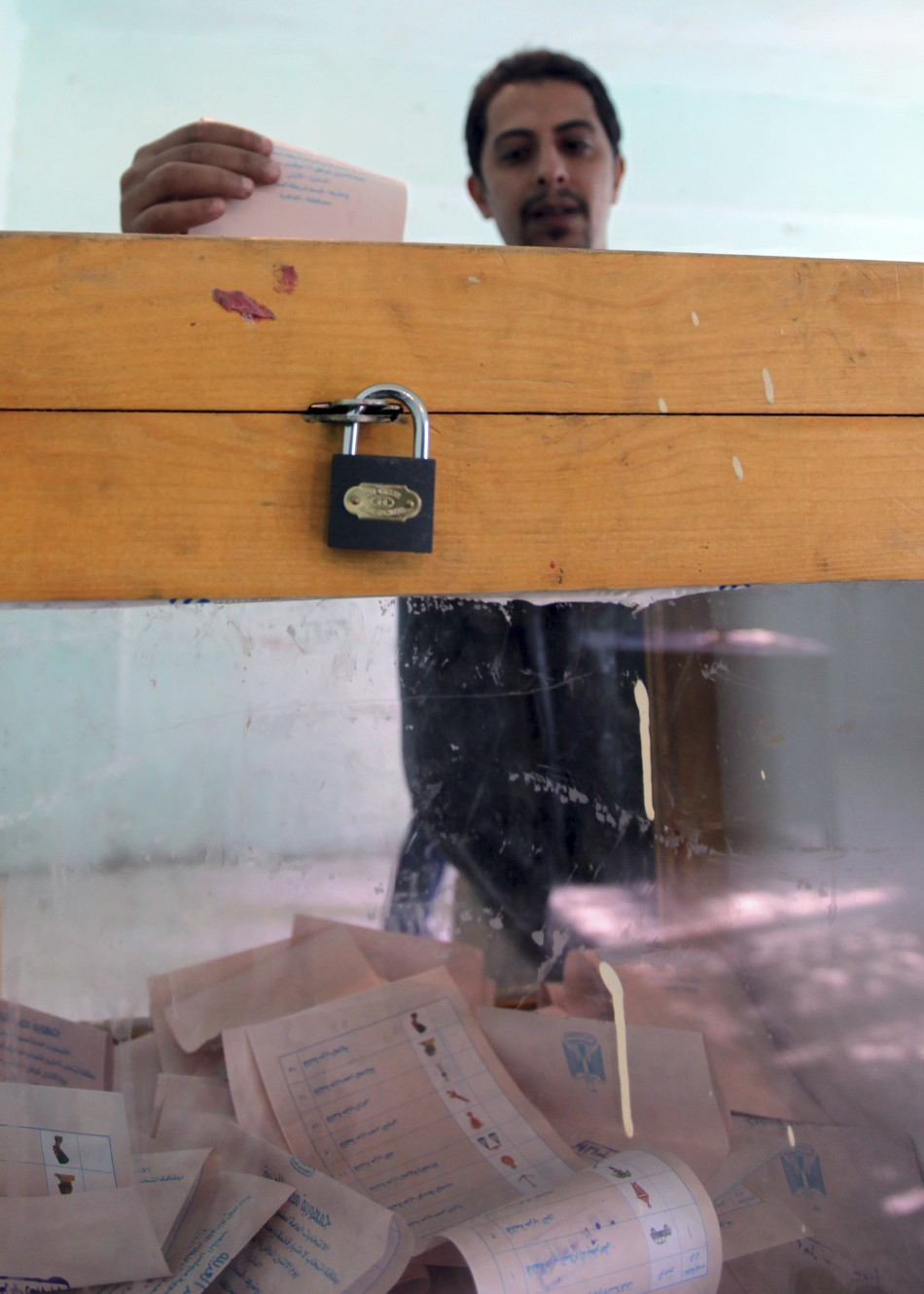 A man casts his vote at a polling station during parliamentary elections in Cairo
