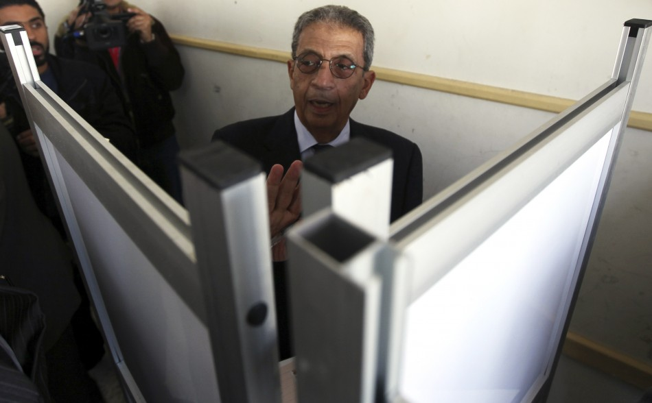 Presidential candidate Amr Moussa arrives to cast his vote at a polling station during a parliamentary election in Cairo