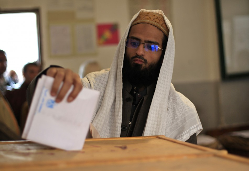 An Egyptian man casts his vote at a polling station during Parliamentary elections in Cairo