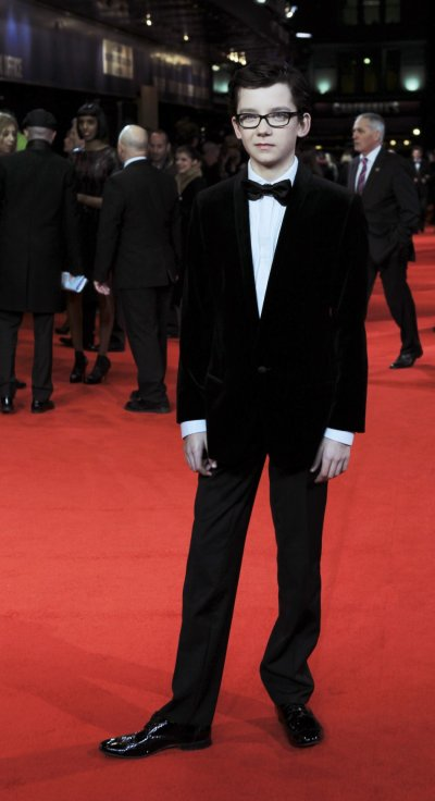 Actor Asa Butterfield arrives at The Royal Premiere of director Martin Scorseses film Hugo at the Odeon Leicester Square cinema in London