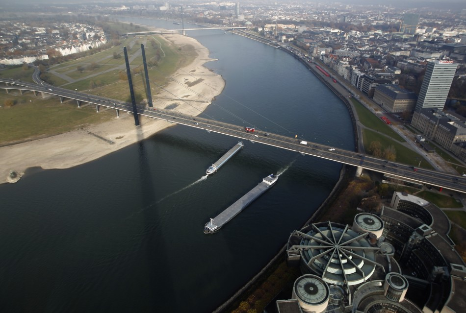 Ships pass the Rhine river with a partially dried-up riverbed in the western town of Dusseldorf