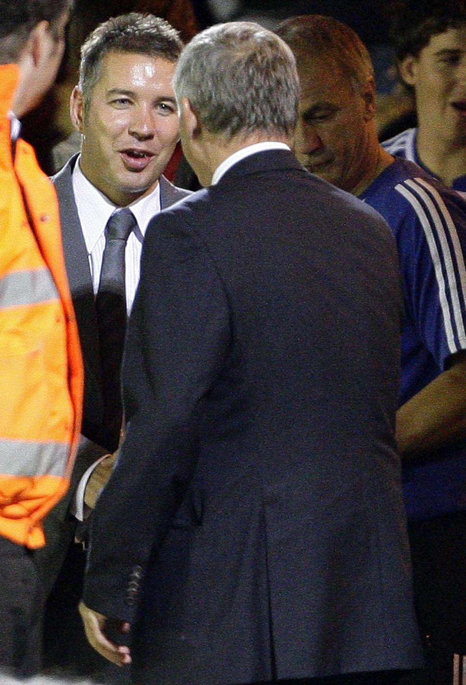 Manchester United's manager Ferguson shakes hand of his son and Peterborough United manager Darren after their pre-season friendly soccer match in Peterborough