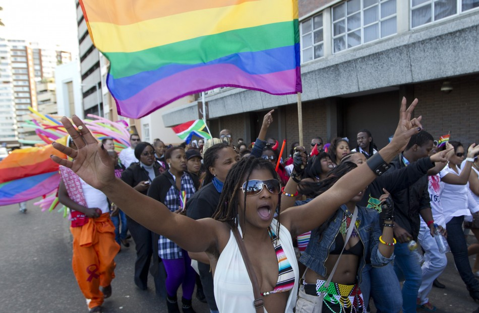 A woman holds her hands up during the Durban Pride parade where several hundred people marched through the Durban city centre in support of gay rights