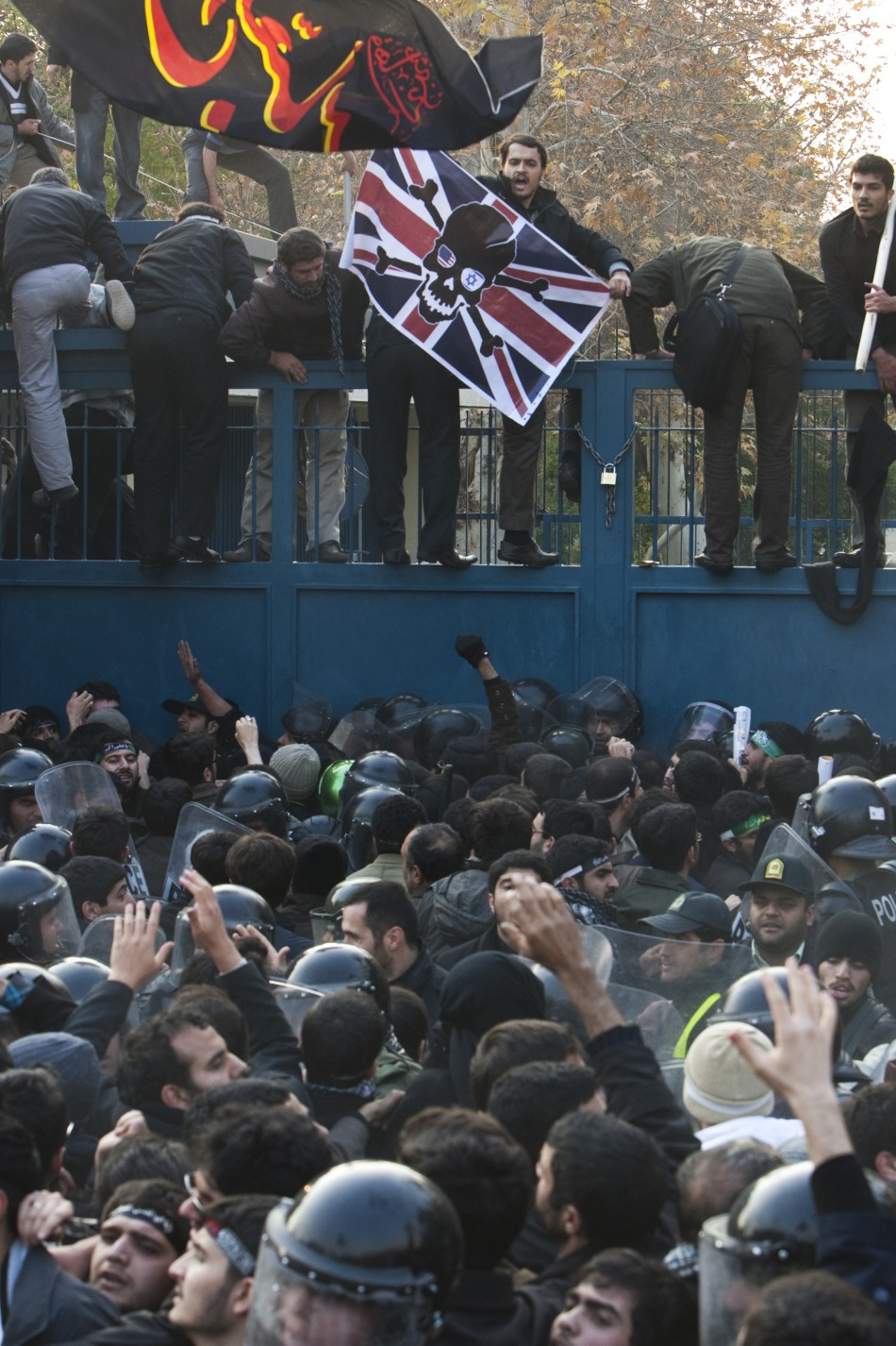 Iranian protesters try to enter the British embassy in Tehran