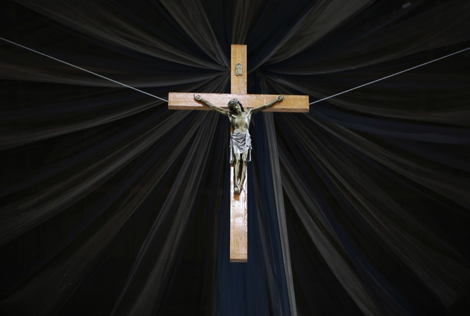 A crucifix hangs inside a Roman Catholic cathedral in the capital Pristina