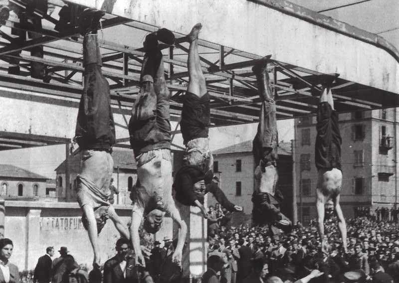 Mussolini hanging from a lamppost along with Claretta Petacci and other fascists