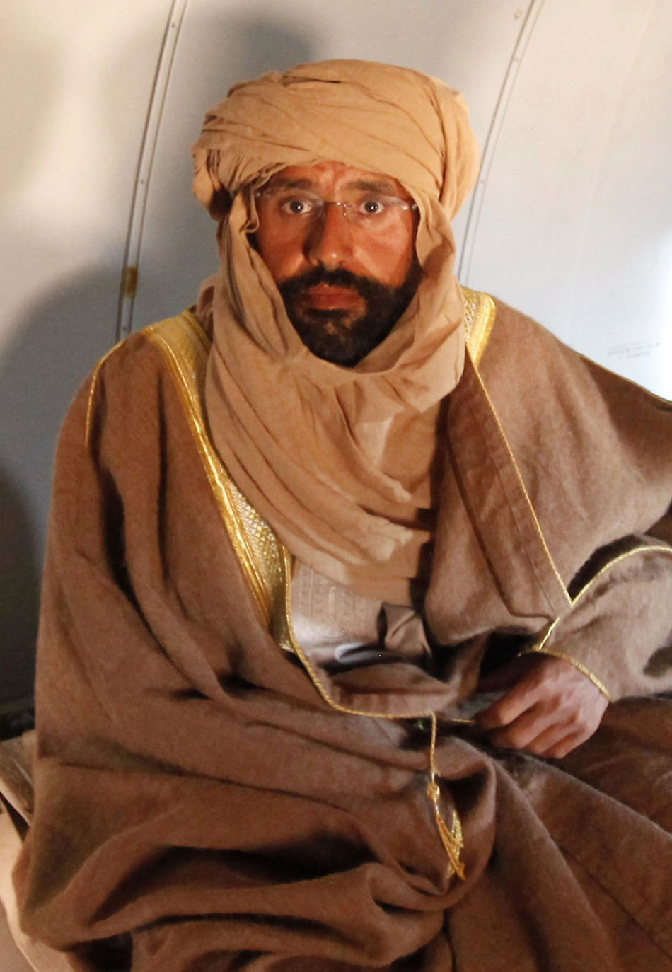 Saif Gaddafi sitting in Zintan after arrest on November 19