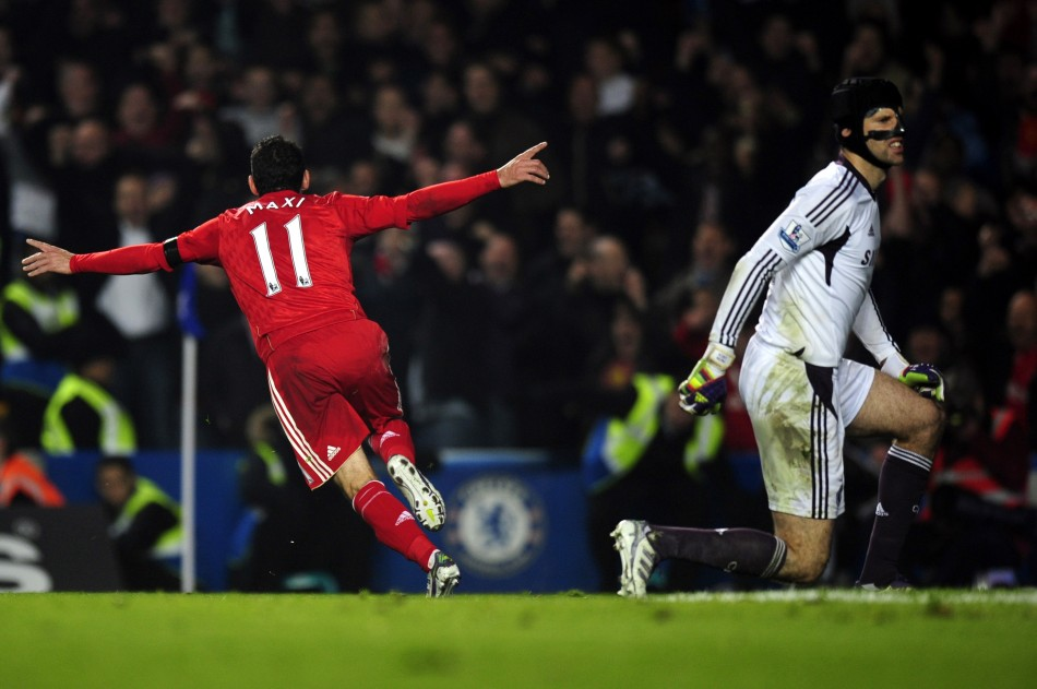 Liverpool's Maxi Rodriguez celebrates after scoring a goal as Chelsea's Cech reacts during their English Premier League soccer match at Stamford Bridge in London