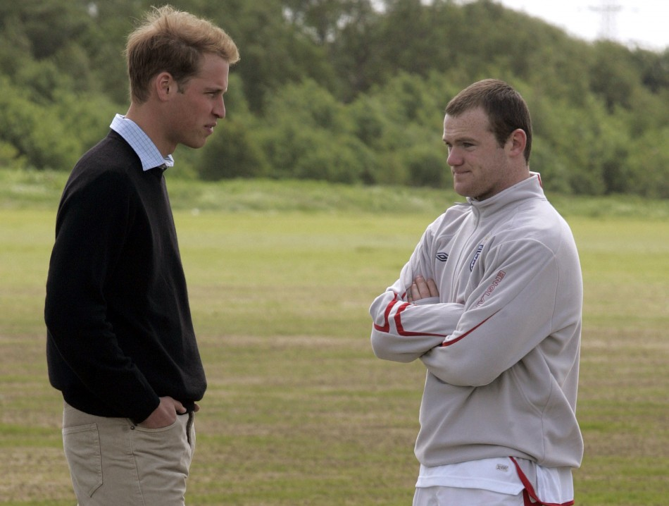 England player Wayne Rooney chats with Prince William during a training session at Manchester Uniteds Carrington complex in Manchester, northern England, June 1, 2006.