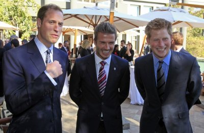 Princes William L, Harry and David Beckham C speak with the media during a reception organised by the British Football Association in Johannesburg, June 19, 2010