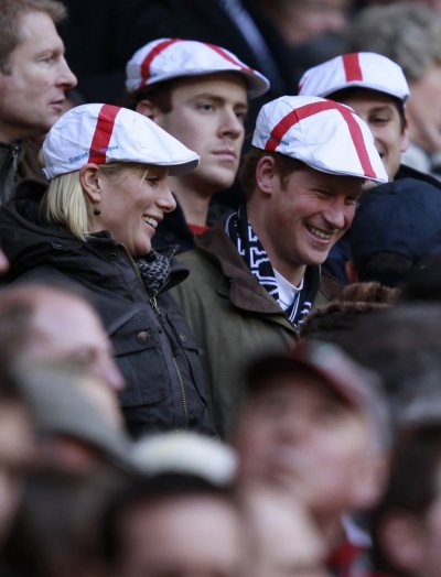 Britains Zara Phillips L talks to Prince Harry before the Six Nations rugby union match between England and France at Twickenham Stadium in London February 26, 2011