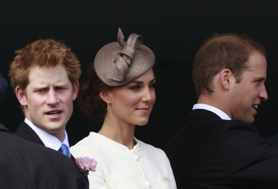 Britains Prince Harry L, Catherine the Duchess of Cambridge, and Prince William stand on the balcony of the Royal box before the Derby at Epsom Racecourse in southern England June 4, 2011.