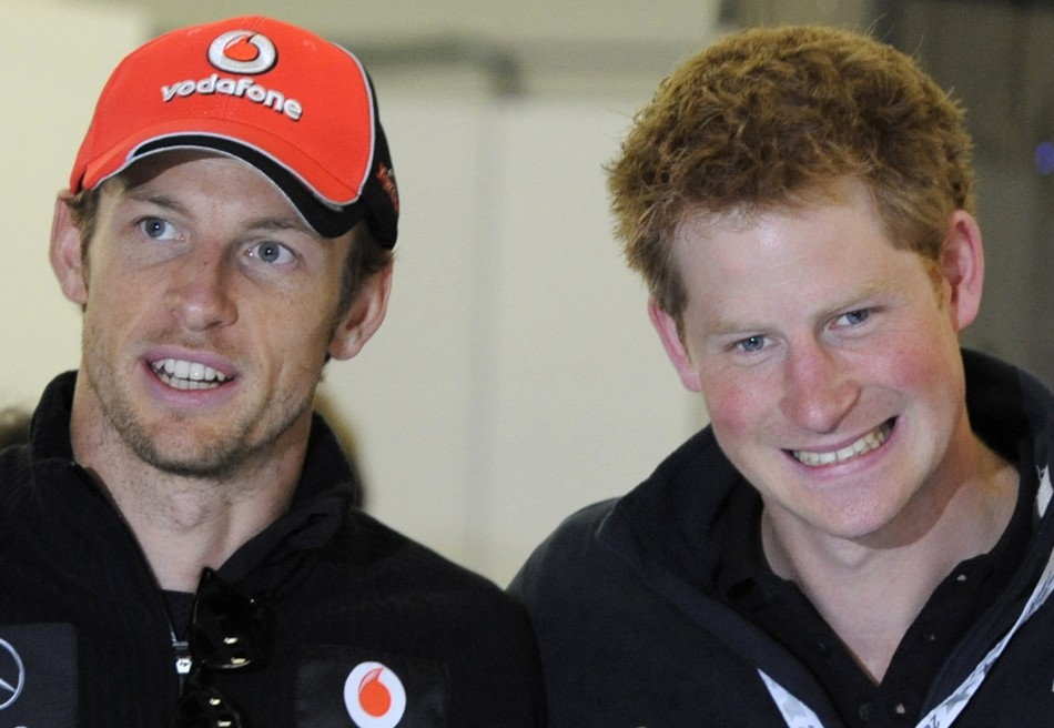 McLaren Formula One driver Jenson Button of Britain speaks with Prince Harry before the British F1 Grand Prix at Silverstone