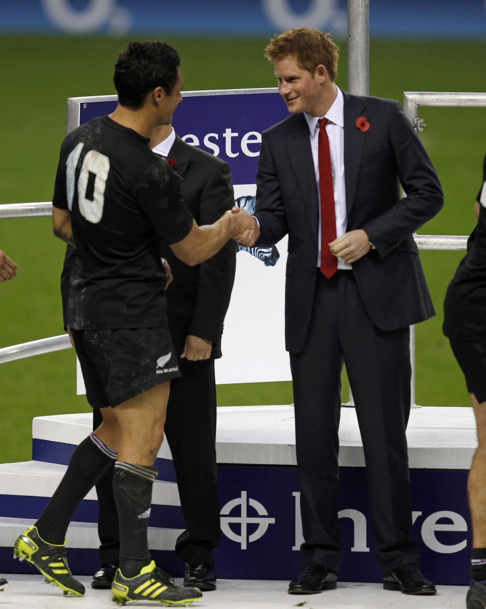 Britains Prince Harry R shakes hands with New Zealands Dan Carter after they won their friendly international rugby match match against England at Twickenham in London November 6, 2010