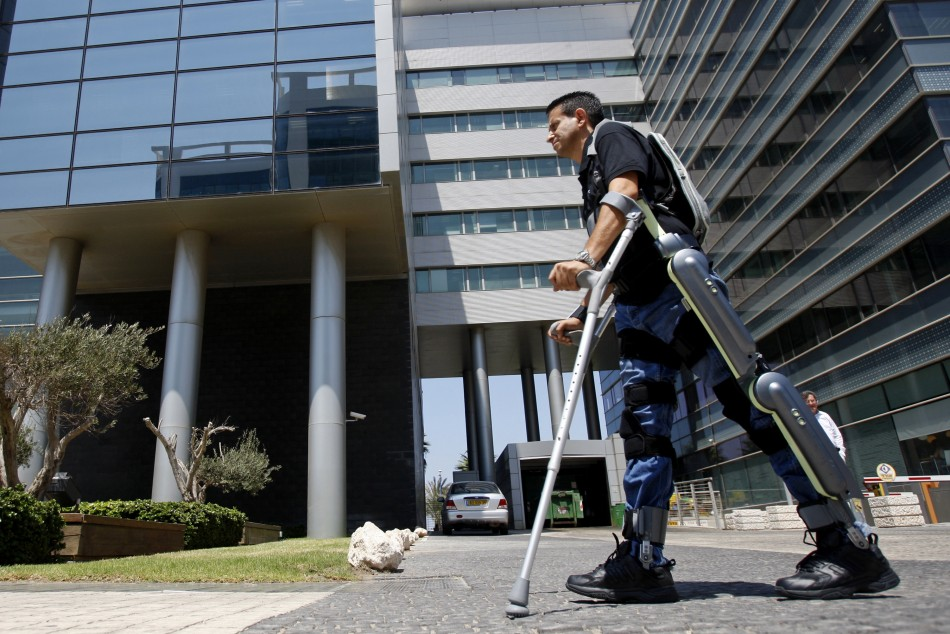 Radi Kaiof walks using an electronic exoskeleton at a development center in the northern city of Haifa