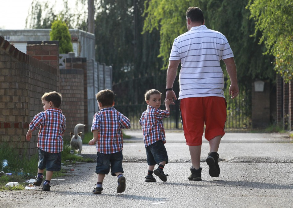 A man walks with his three children