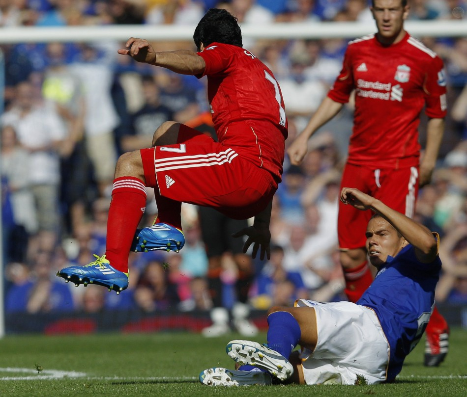 Everton's Rodwell fouls Liverpool's Suarez before being sent off during their English Premier League soccer match in Liverpool