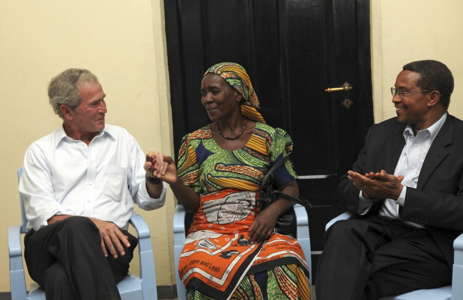 Former U.S. President George Bush and Tanzanian President Jakaya Kikwete congratulate cancer survivor Theresia Cosmas Chibongo as they visit Ocean Road Cancer Institute in Dar es Salaam