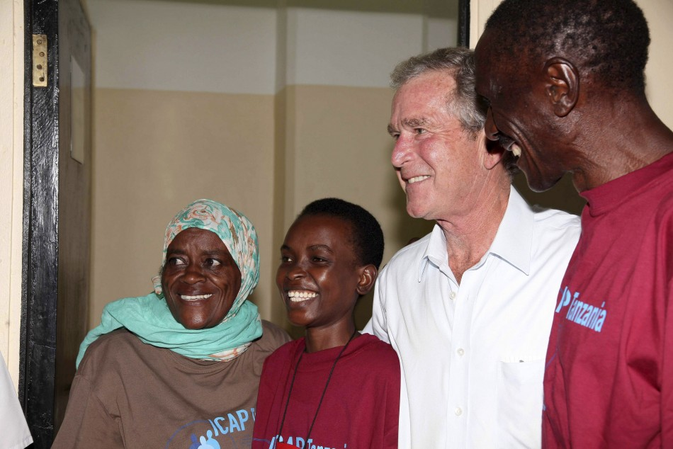 Former U.S. President George W. Bush and Tanzanian President Jakaya Kikwete pose for photographs with HIV/AIDS and cancer patients as they visit Ocean Road Cancer Institute in Dar es Salaam
