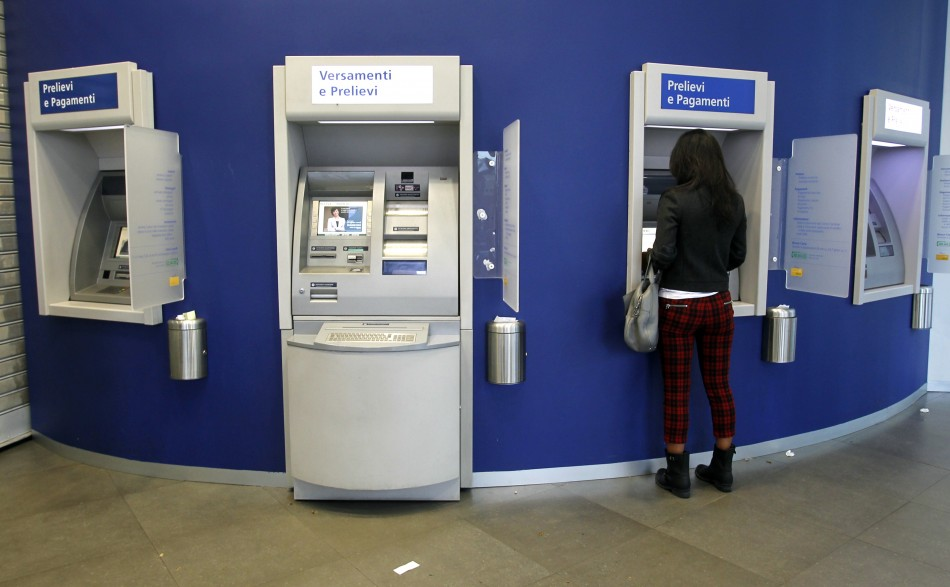 A woman using a ATM machine