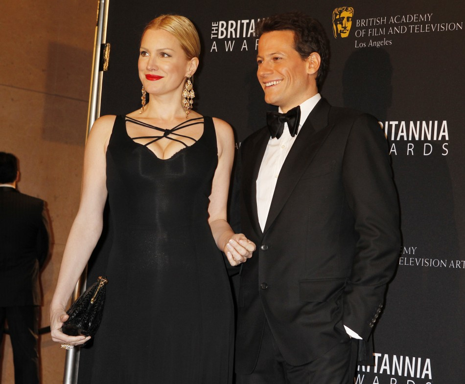 Actors Ioan Gruffudd and Alice Evans (L) pose as they arrive at the British Academy of Film and Televison Arts Los Angeles Britannia Awards in Beverly Hills, California