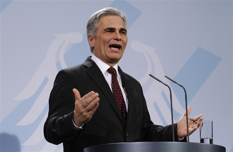 Austrian Chancellor Faymann addresses media in Berlin December 2, 2011.