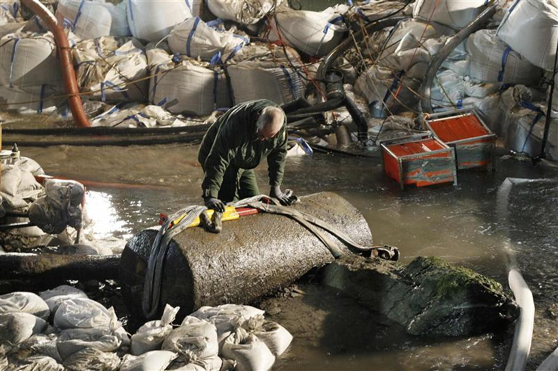 Member of the German bomb disposal squad stands next to a World War II bomb following its sucessful defusion in Koblenz