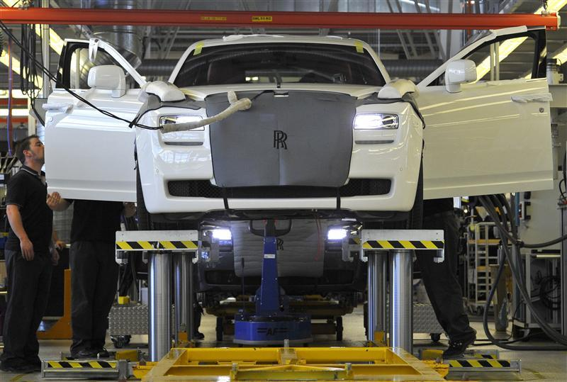 Employees work in the finishing and testing areas at the Rolls Royce plant in Goodwood