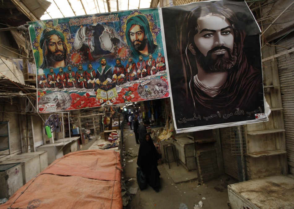 Posters of Imam Hussein are sold during ceremony of Ashura at Shurja wholesale market in central Baghdad