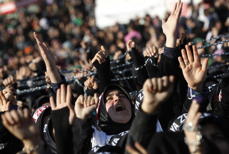 Shiite women shout Islamic slogans as they mourn during an Ashura procession in Istanbul