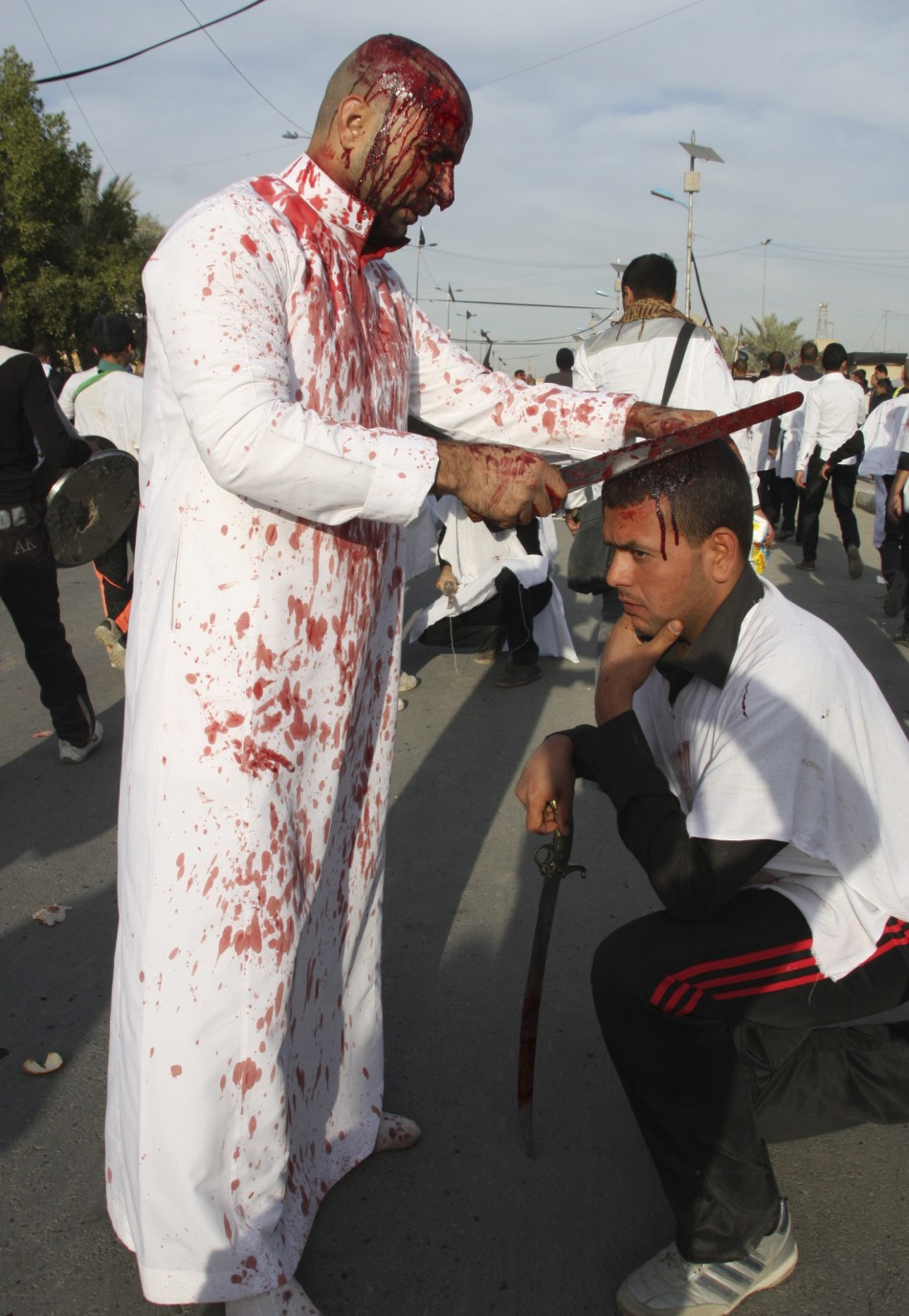 Shi'ite Iraqi men covered in blood take part in the Ashura procession in Baghdad's Sadr City