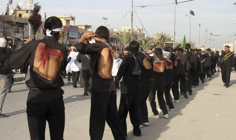 Shiite men flagellate themeselves during a ceremony marking the Ashura procession in Baghdads Sadr City