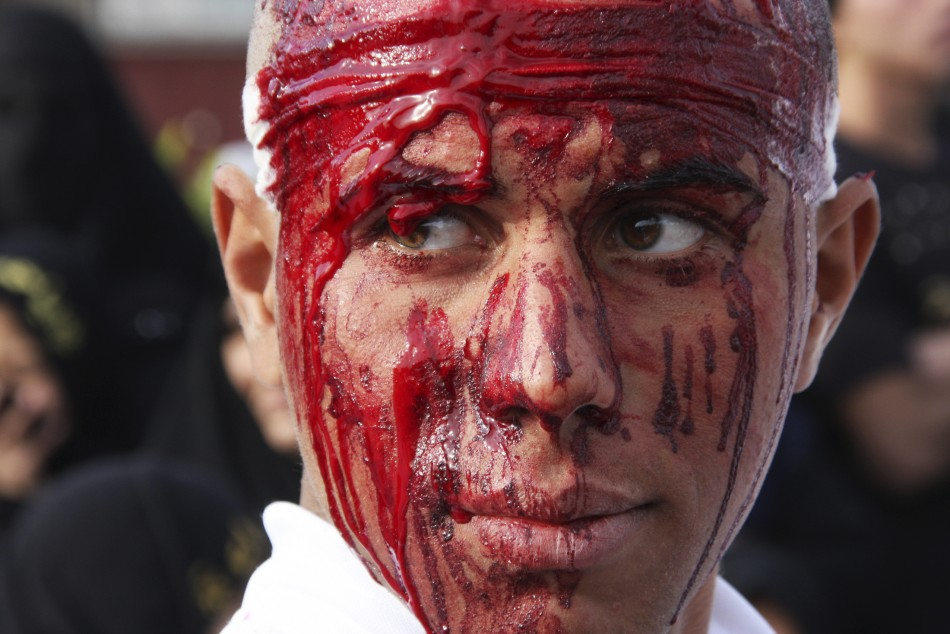 A Shi'ite man covered in blood takes part in the Ashura procession in Baghdad's Sadr City