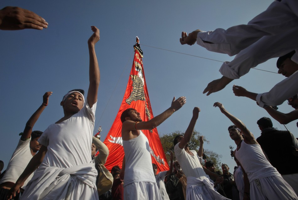 Shiite Muslims beat their chests as they take part in a religious procession ahead of the Ashura festival in Islamabad