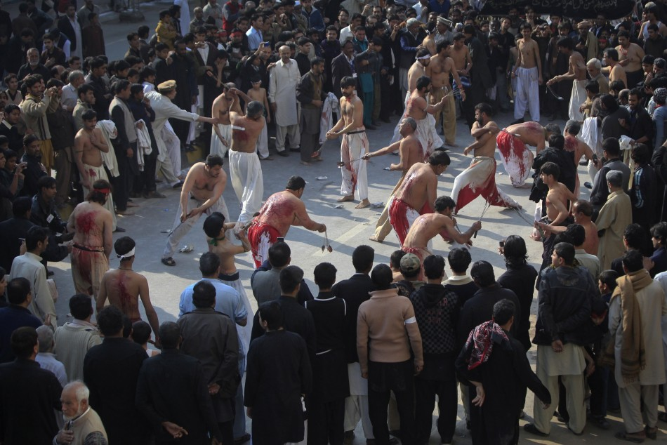 Shi'ite Muslim men take part in self-flagellation during a religious procession ahead of the Ashura festival in Peshawar 05/12/2011
