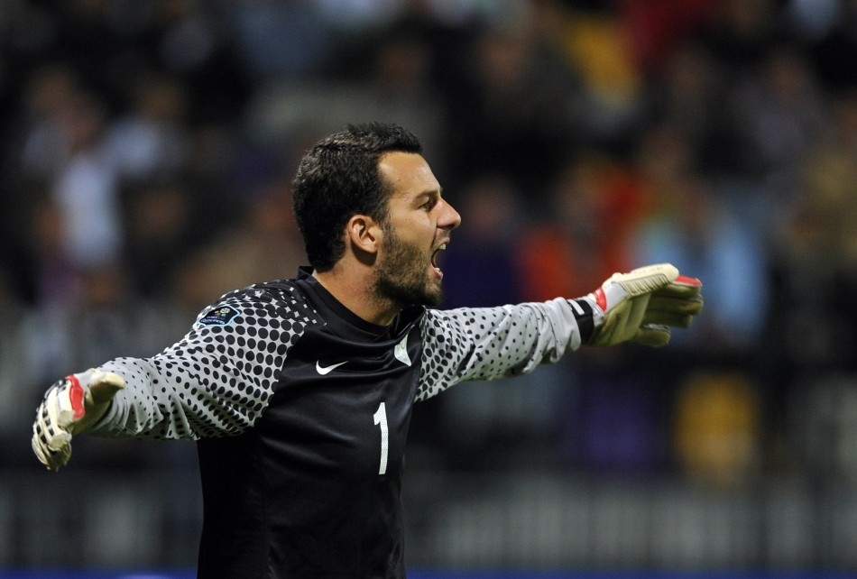 Slovenia's Handanovic reacts during their Euro 2012 Group C qualifying soccer match against Serbia in Maribor