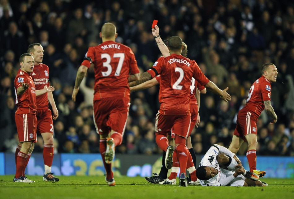 Liverpool's Jay Spearing reacts as he is shown the red card after fouling Fulham's Mousa Dembele during their English Premier League soccer match at Craven Cottage in London