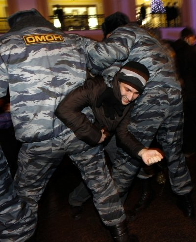 Russian Interior Ministry troops detain a participant