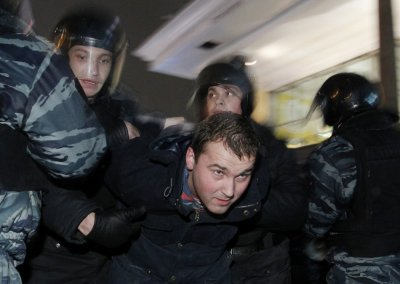 Russian police detain a participant