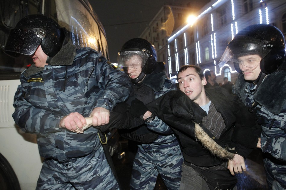 Russian police detain a participant during an opposition protest in central Moscow December 5, 2011