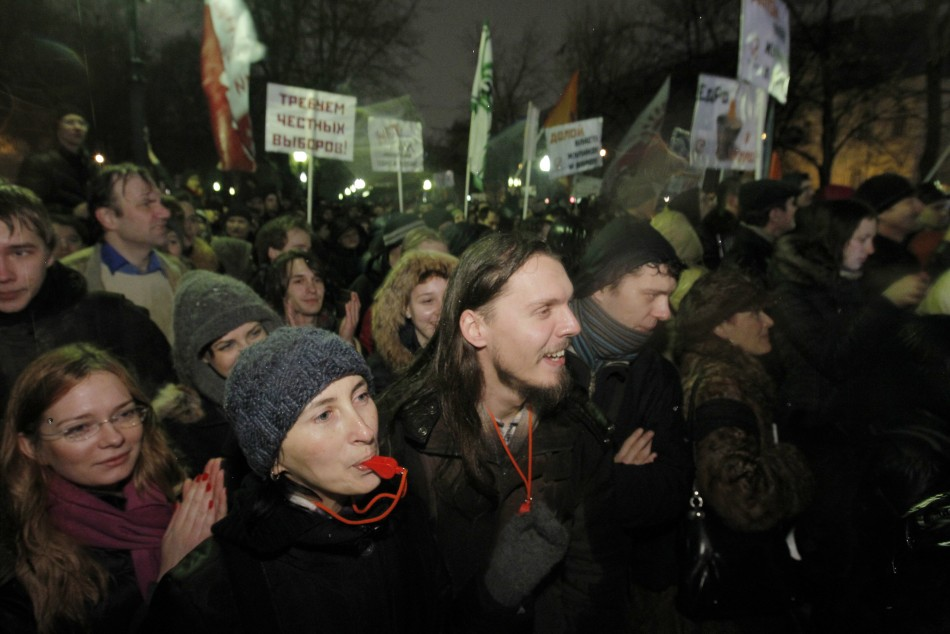 Participants blow whistles and shout during an opposition protest in central Moscow December 5, 2011.