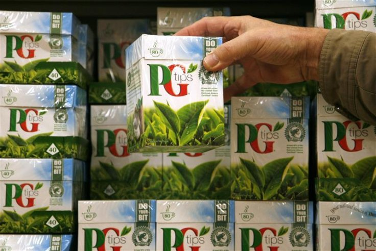 A shopper picks up a box of PG Tips tea bags at a Sainsbury's supermarket in London