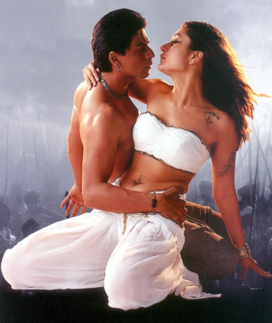 Popular Indian actor Shah Rukh Khan L holds co-star Kareena Kapoor in an undated publicty still fr..