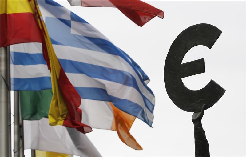 File photo of Greek and others European national flags fluttering near an euro symbol outside the EU Parliament in Brussels