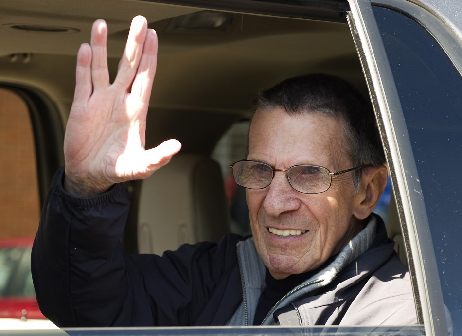 "Actor Nimoy gives the ""Vulcan salute"" to the crowd while riding in a parade in the town of Vulcan"