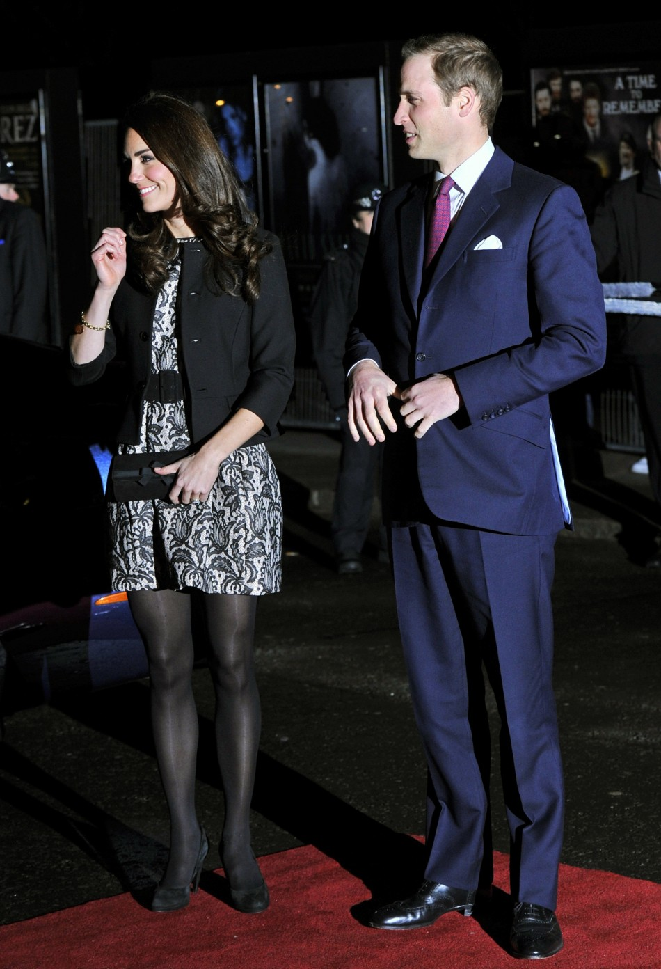 Britain's Kate Middleton, Duchess of Cambridge, arrives with her husband Prince William for a charity concert at the Royal Albert Hall in London
