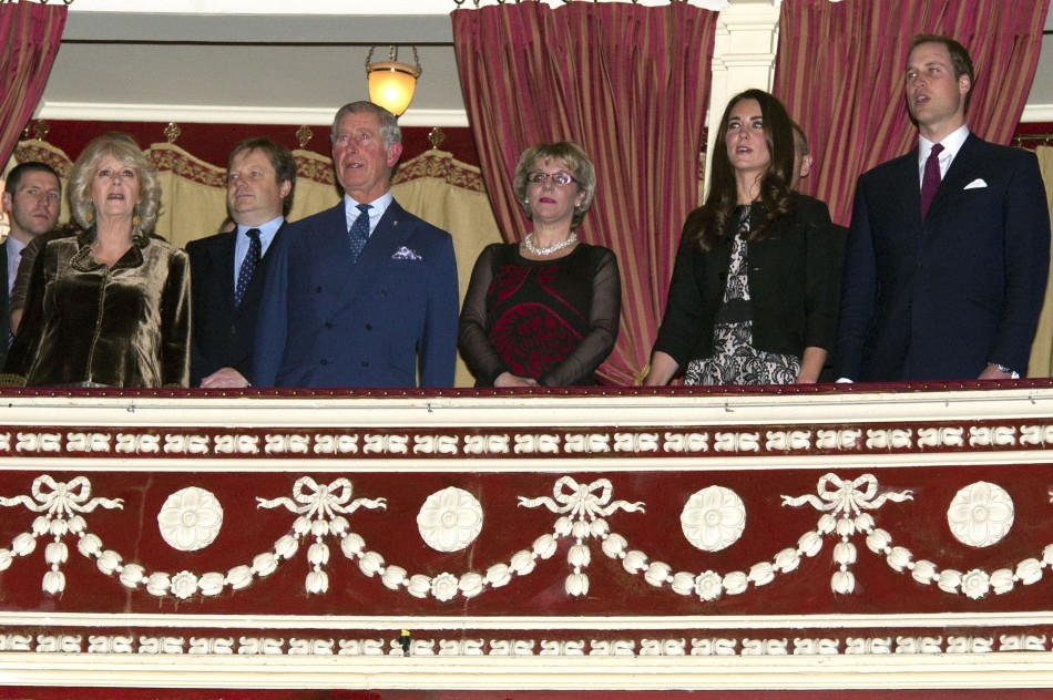 Prince William (R) and Catherine, Duchess of Cambridge (2nd R) attend a fund raising concert with Prince Charles and Camilla, Duchess of Cornwall at the Royal Albert Hall in London on December 6, 2011.