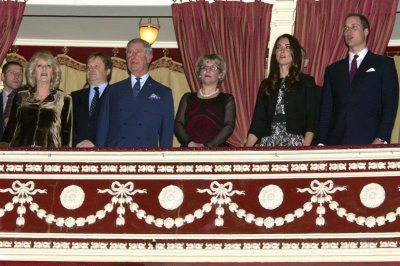 Prince William R and Catherine, Duchess of Cambridge 2nd R attend a fund raising concert with Prince Charles and Camilla, Duchess of Cornwall at the Royal Albert Hall in London on December 6, 2011.